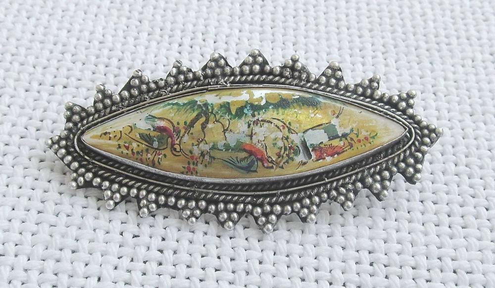 Vintage painted miniature on mother of pearl filigree and silver sterling 935 brooch.