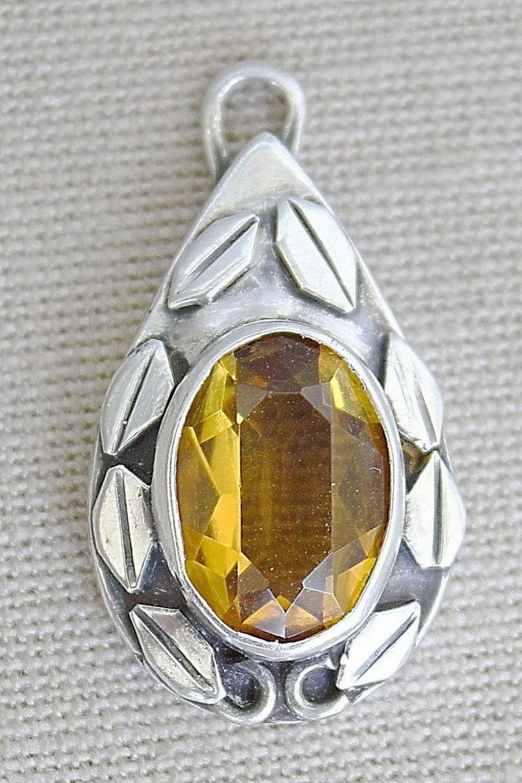 Vintage silver sterling floral pendant set with faceted topaz.