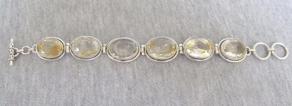 Art deco bracelet - faceted yellow topaz framed in silver sterling , 42 gr.