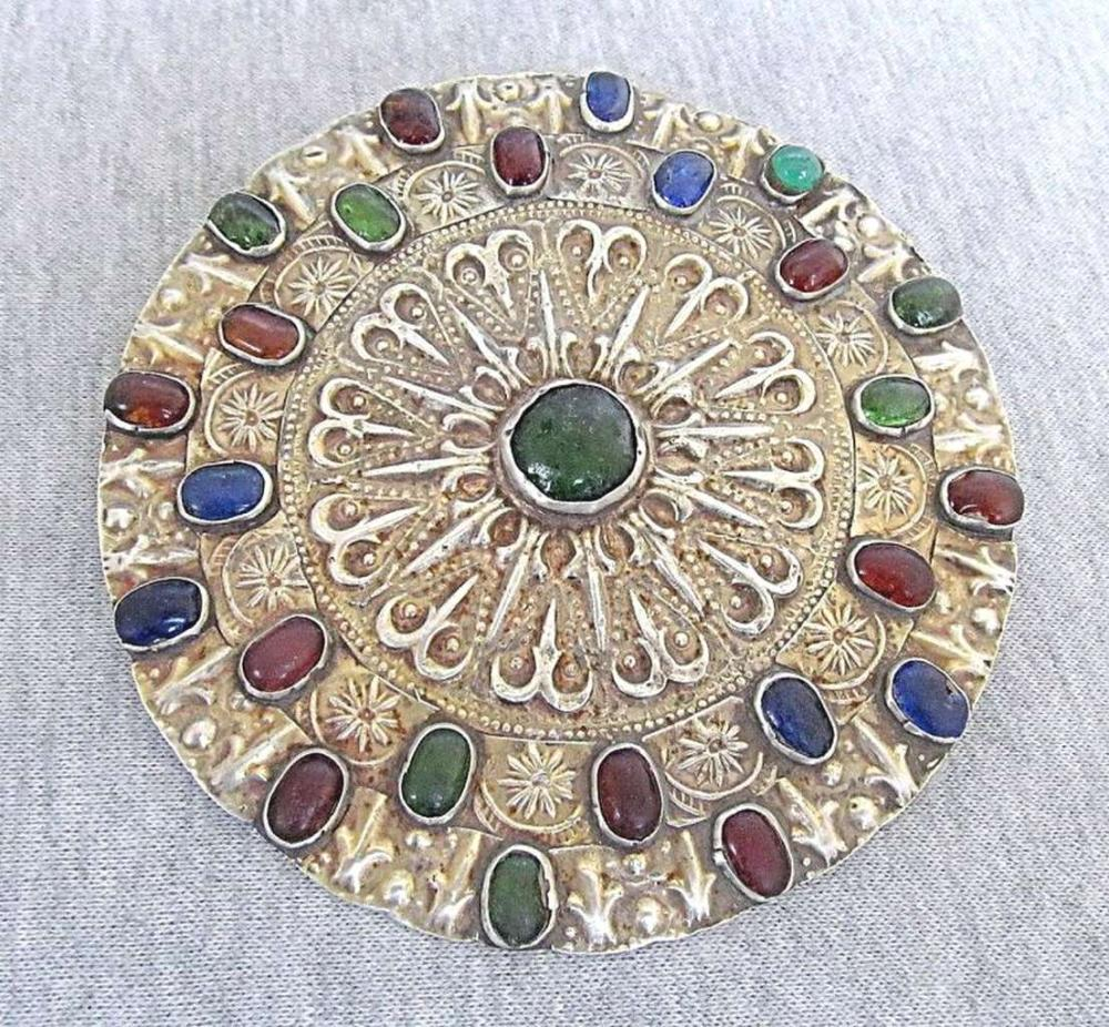 A Yomut Silver Gilt Breast Gulyhaka Ornament set with gemstones and glass, 70gr.
