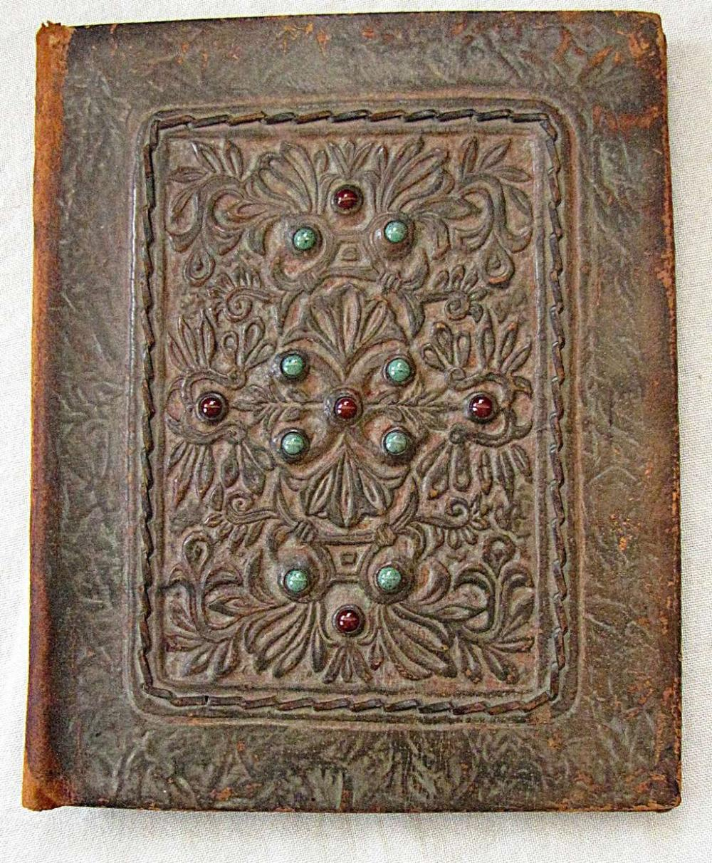 Bezalel. Stamped Leather Paper Folder set with turquoise and garnet .