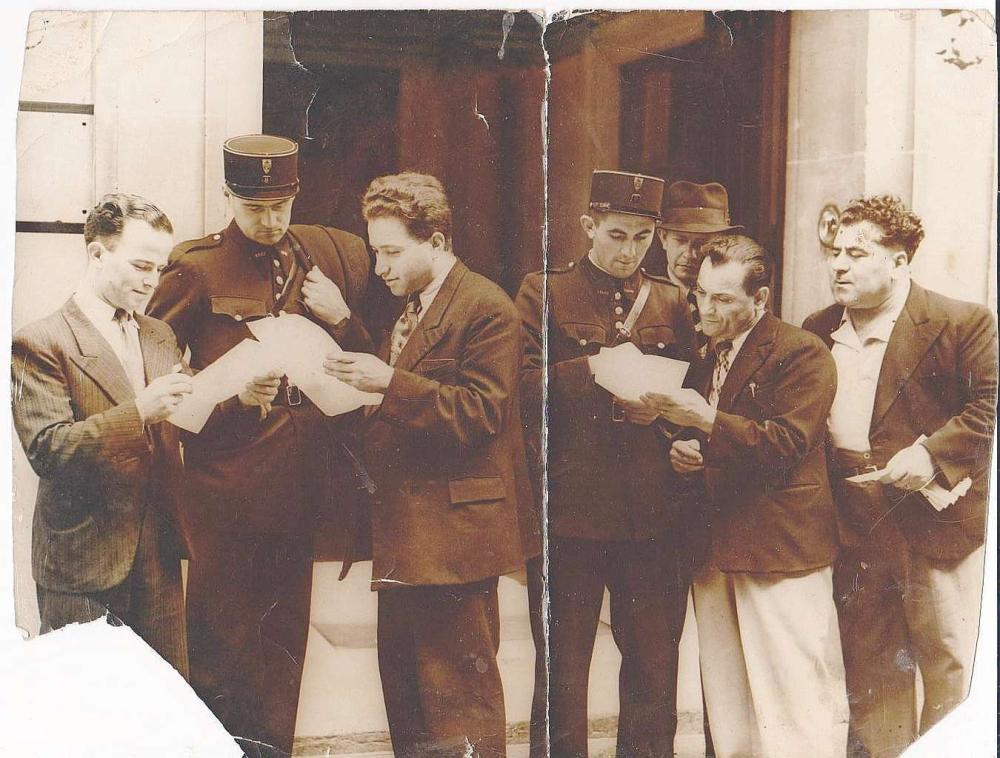She'erit Ha-Pleita. Paper proof. Photo of Jewish Refugees with French Gendarmerie. Paris. 1945-46 Damaged