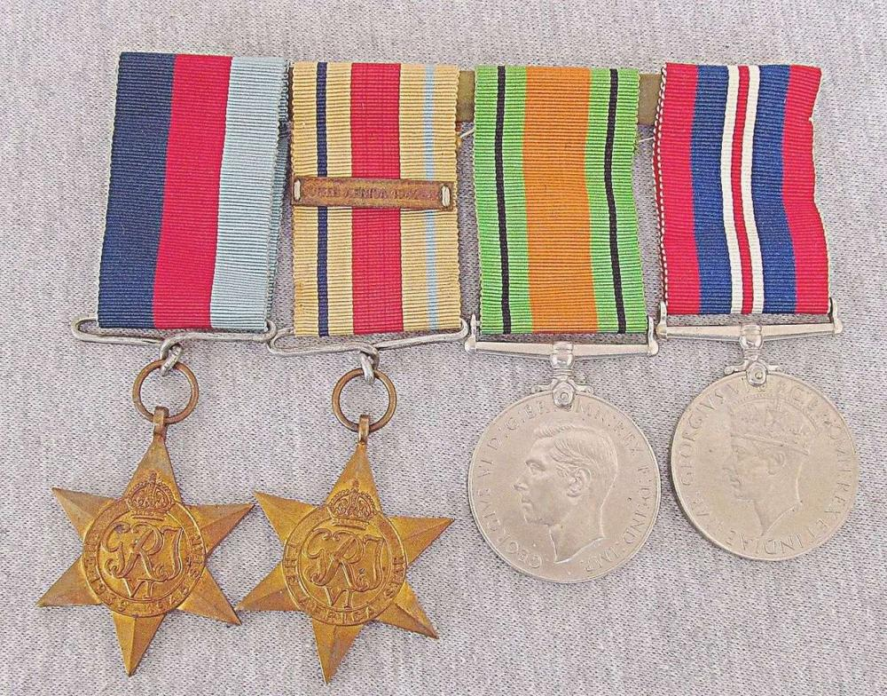 WWII GREAT BRITAIN. SET 4 MEDALS THE AFRICA STAR 1942-43 DEFENSE MEDAL 1939-1945