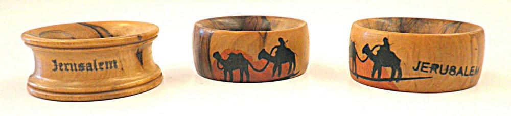 Bezalel 3 painted olive wood napkin rings, signed: Jerusalem.