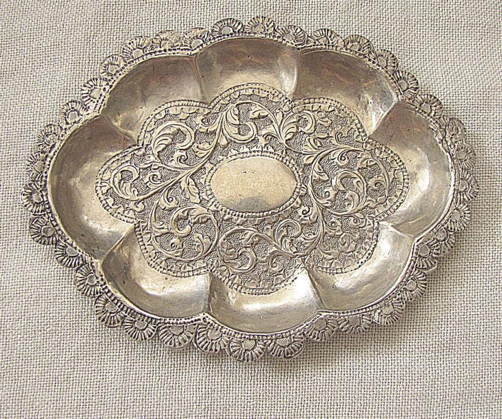 Antique oriental oval plate with floral engraving, 62gr., tested