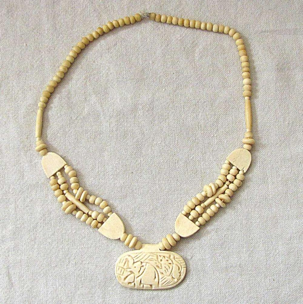 African Antique tribal carved ivory necklace with carved elephant pendant, 66gr.