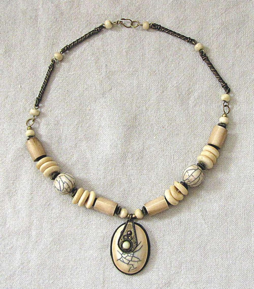 African Antique tribal carved ivory necklace with metal parts, 85gr.