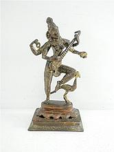 An old Indian bronze figurine, 20th century, a goddess playing a string instrument.
