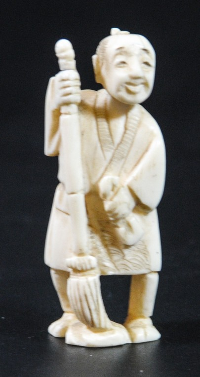 Man with broom, old Japanese ivory netsuke