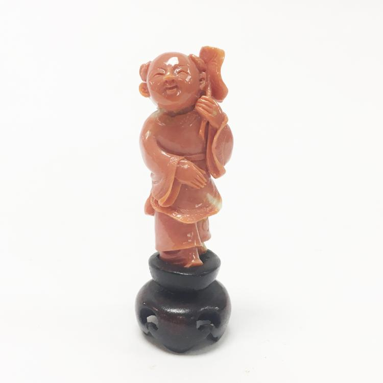 Chinese Carved Coral Deity with Stand