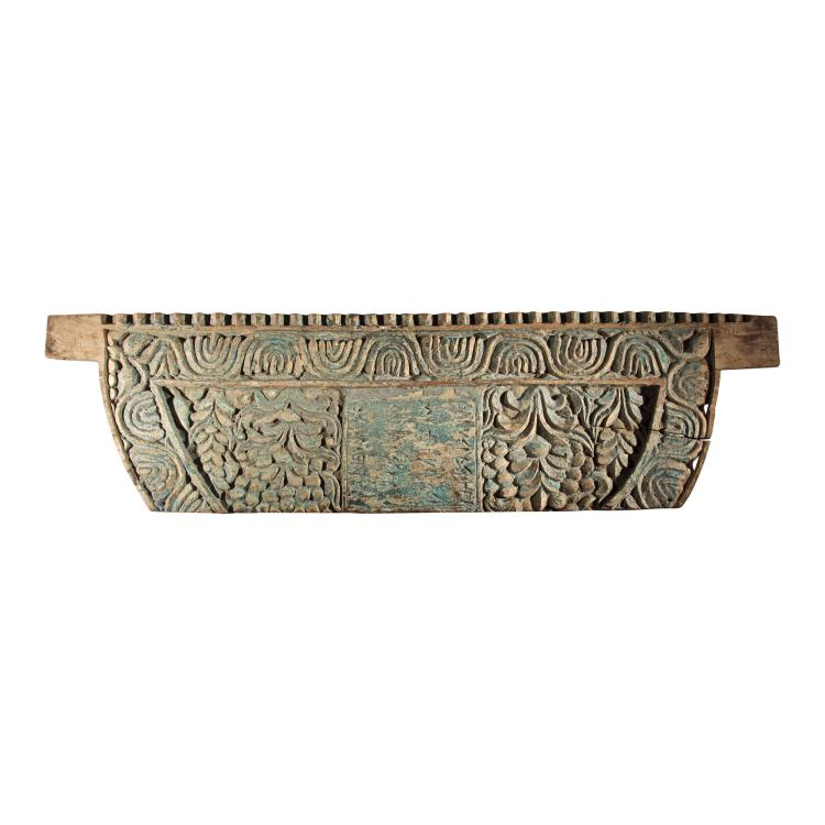 A Carved Wooden Side Panel of A Cart.