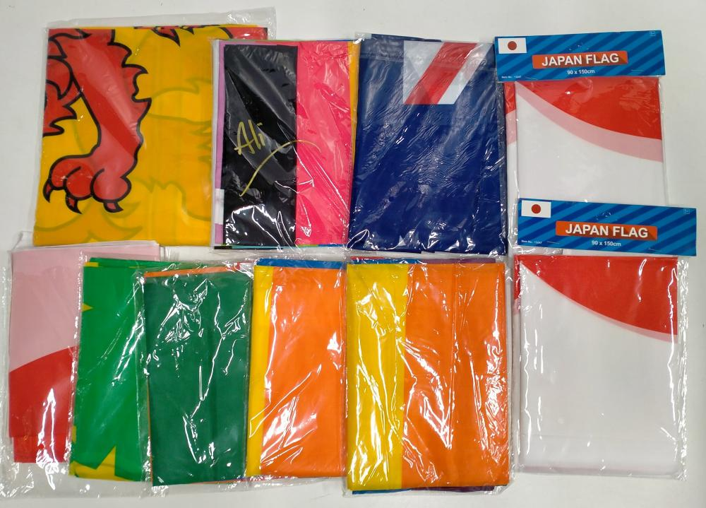 A bag of assorted flags incl. Japanese etc.