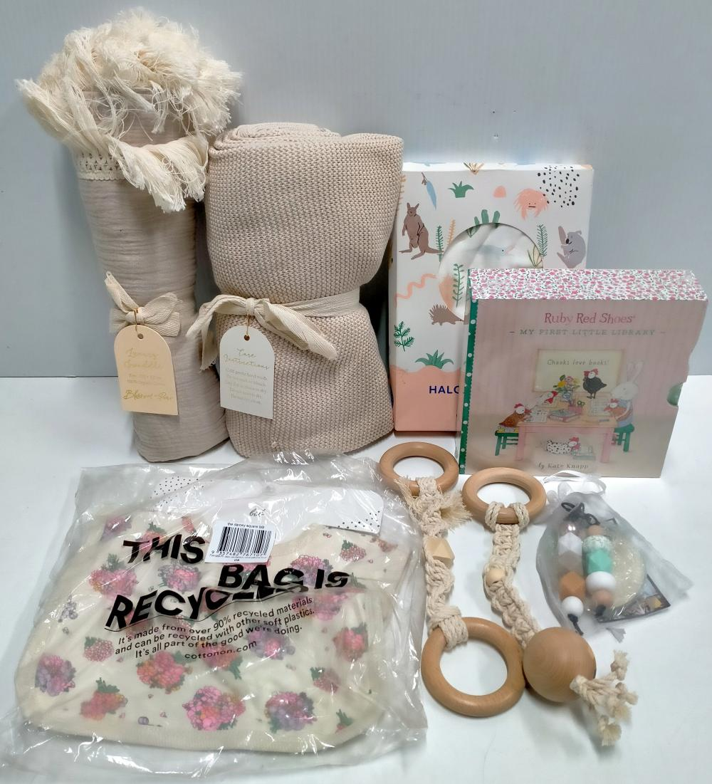 A bag of assorted baby sundries incl. wraps, blanket etc.