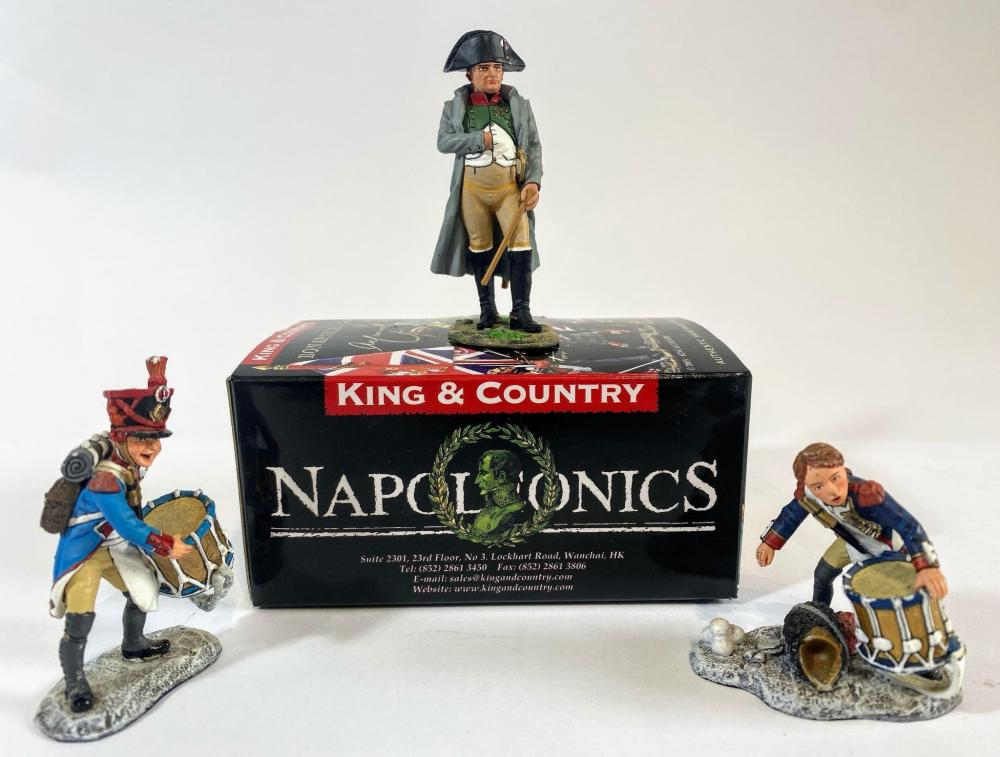 A Collection of Three King & Country Figures Napoleonic Christmas Set 2011 & Napoleon Dismounted in Uniform of the Colonel of The Chasseur a Cheval of the Guard with Box for Napoleon. The Two Drummer Boys Engaged in a Sn