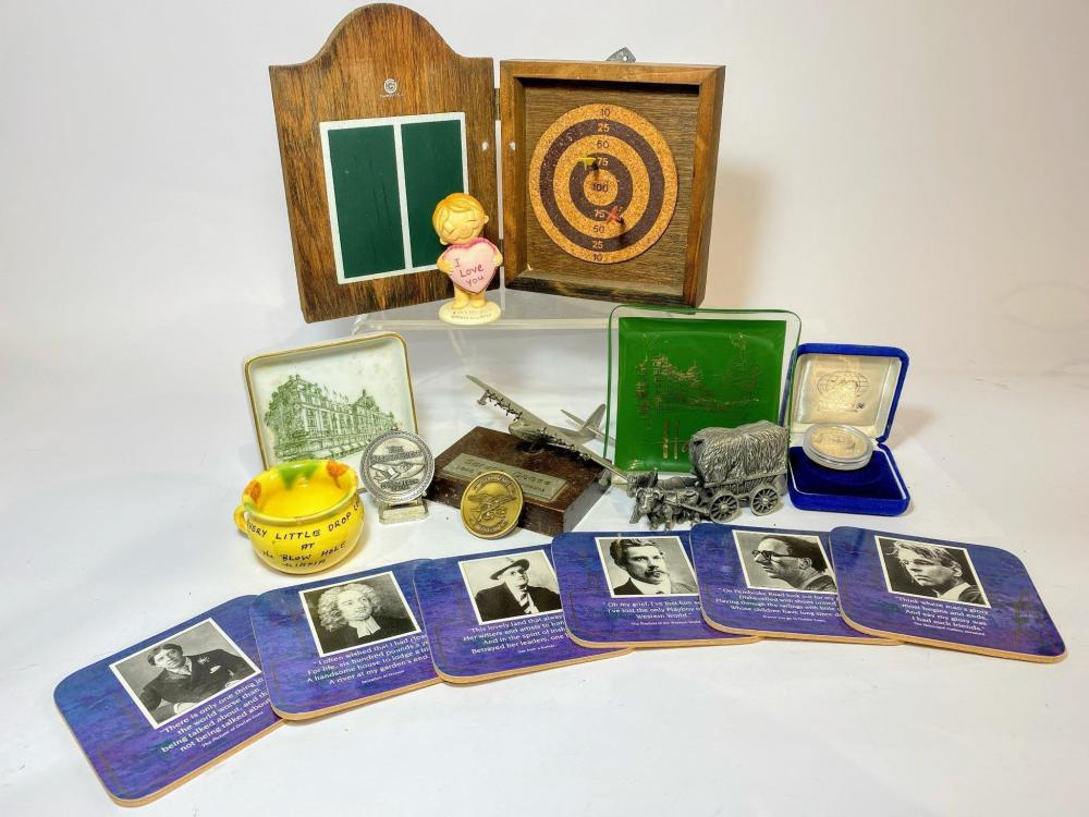 A Collection of Desk Ephemera including a Diecast Spruce Goose Author Portrait Drink Coasters