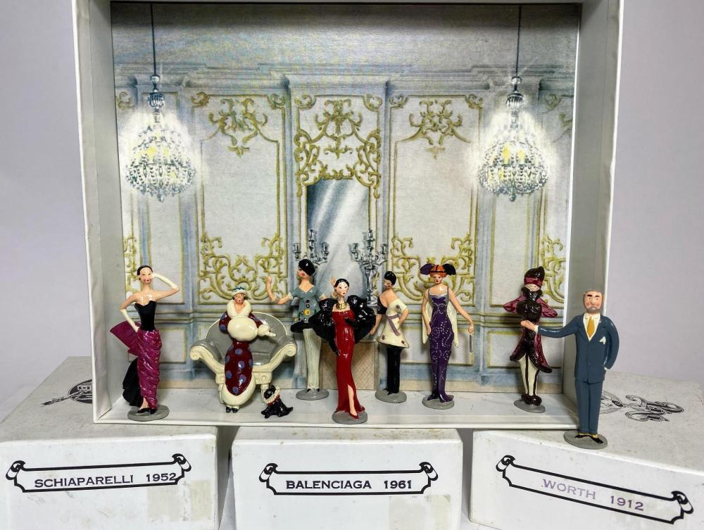 A Collection of Haute Couture figurines in the manner of tin soldiers Dress designs derived from The House of Worth 1912 Schiaparelli 1952 Balenciaga 1961 By Pixi et Cie in collaboration with the Musee De La Mode Paris