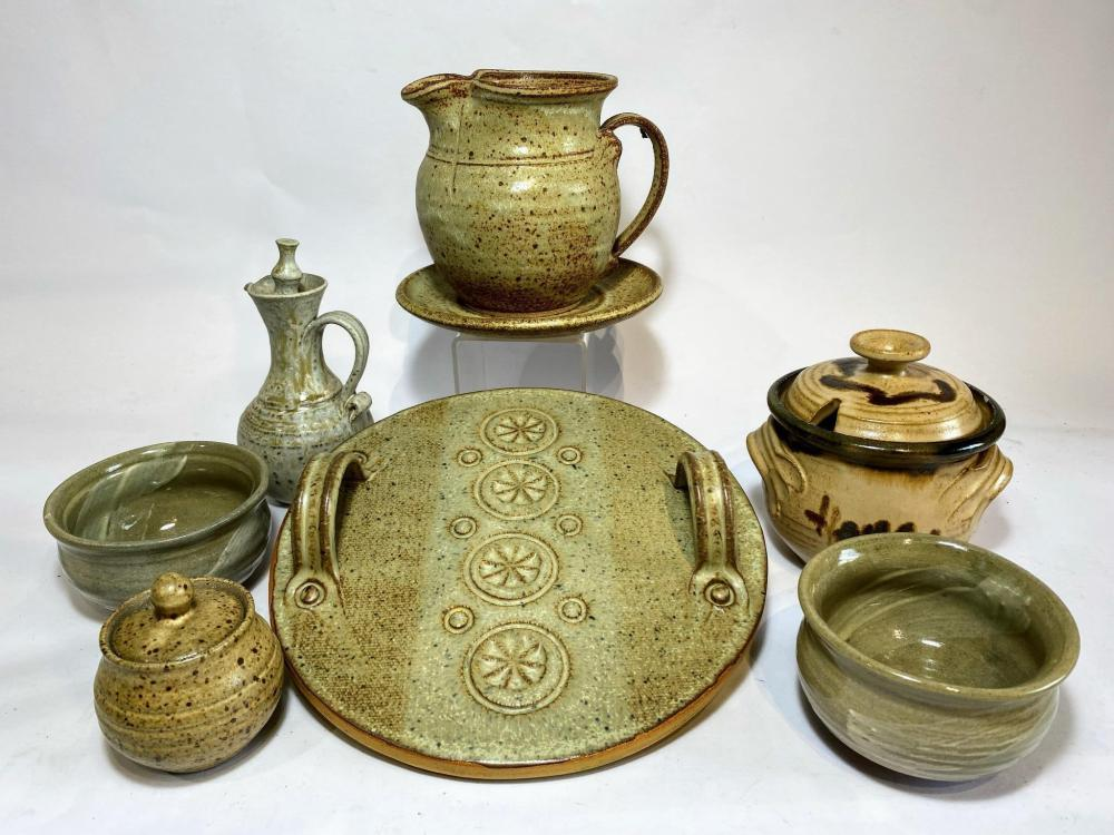 A Collection of Australian Stoneware including Salt Pig Tapenade Bowls Serving Platter and Vinaigrette Bottle