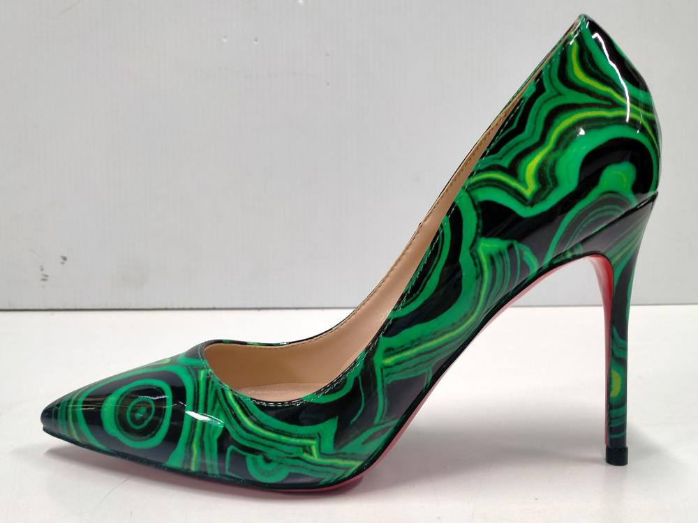 A pair of ladies heels marked Christian Louboutin size 38 with box