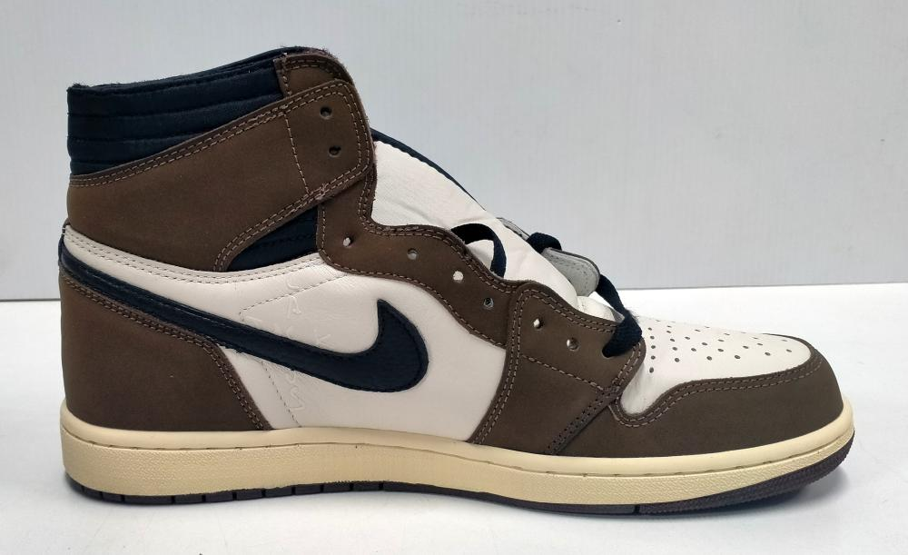 A pair of men's sneakers marked Nike Air Jordan 1 High OG TS SP size UK10 with slightly damaged box