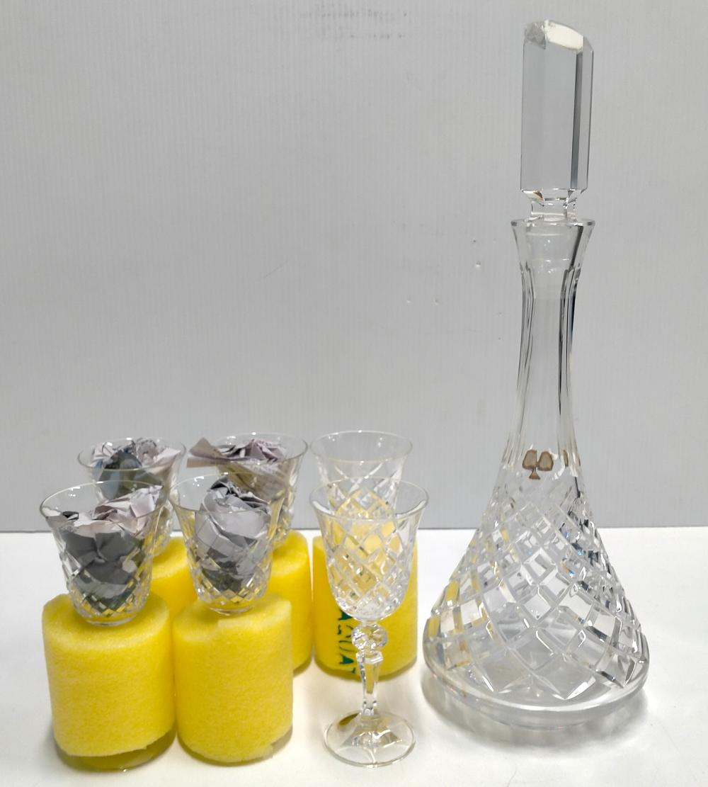 A crystal decanter Ht. 142 cm (chips to stopper) plus six crystal sherry glasses marked Bohemia