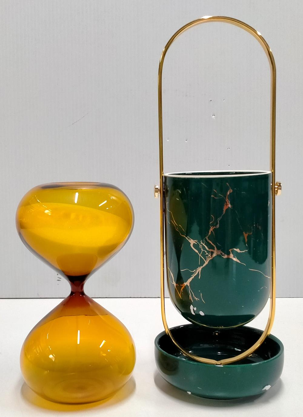 A ceramic utensil holder plus 30 minute sandglass