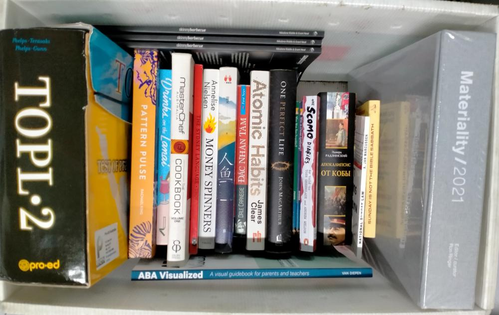 A box of assorted reference books