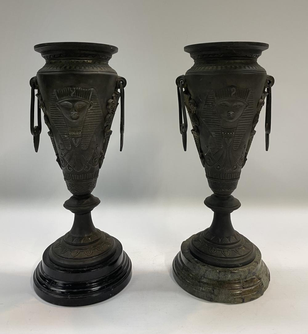 A Pair of Egyptian Revival Pharaoh Motif Urns with Marble Bases