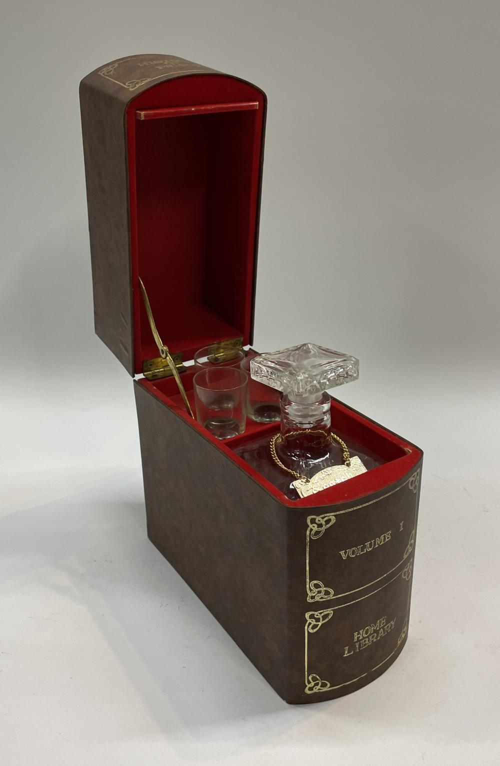 A Scotch Decanter & Shot Glass Set Concealed in a Musical Book Shaped Box Inscribed The History of Music