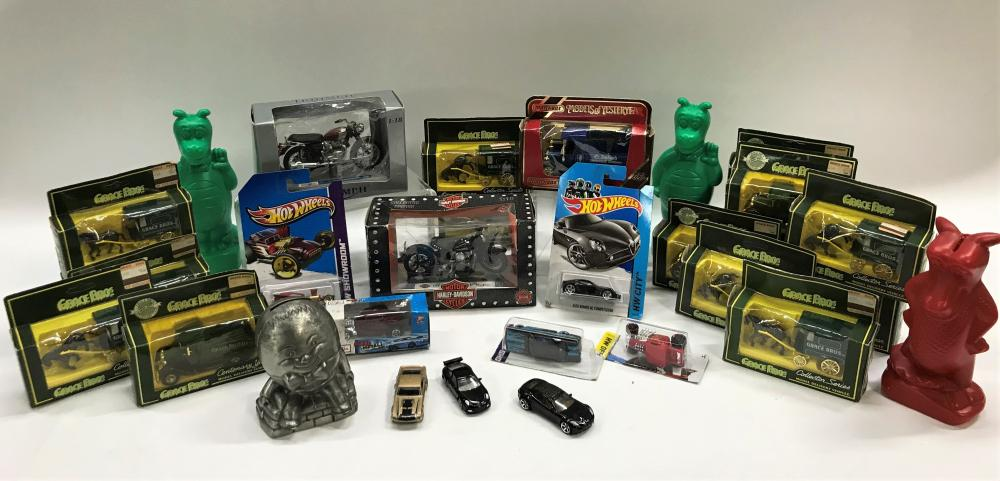 A Large Collection of Model Cars and Money Banks Incl. Harley Davidson, Hot wheels & Grace Brothers