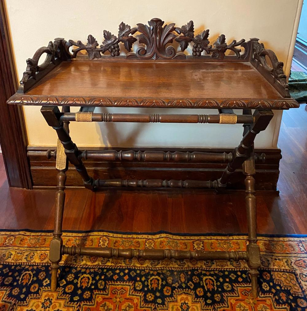 A Carved English Oak Butlers Table with Galleried Top of Grape & Vine Leaves