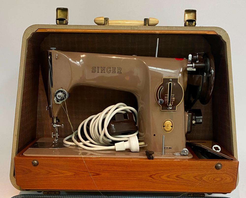 A Singer Sewing Machine in a Case, model no. 201P