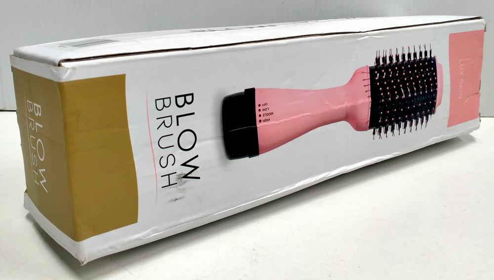 A blow brush marked Lux Skin