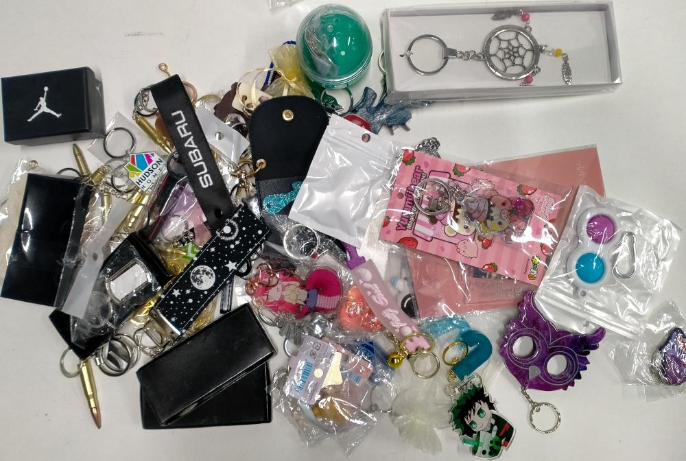 A bag of assorted keyrings