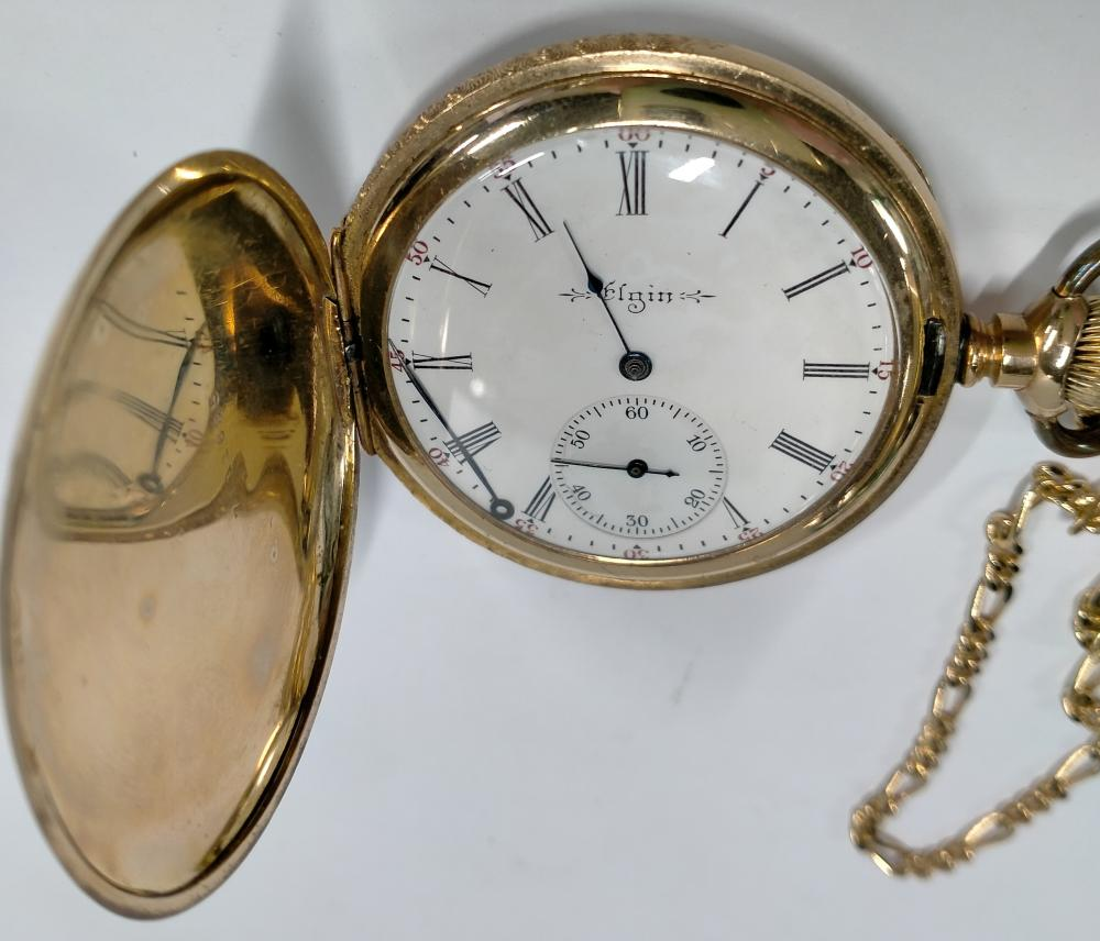 An Elgin gold plated pocket watch with chain, loose hand