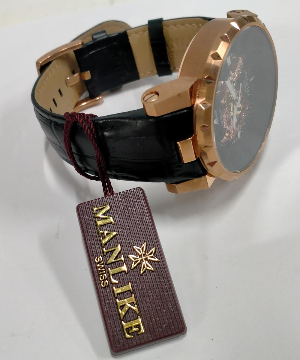 A gent's wrist watch marked Manlike Swiss with original box