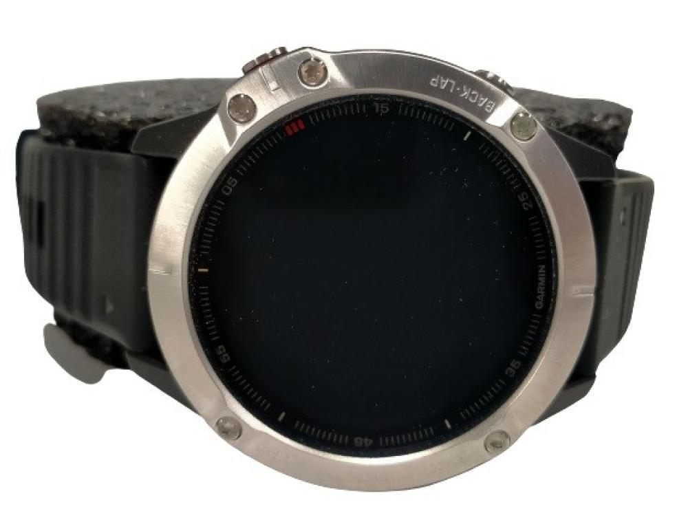 A new & unused smart watch marked Fenix 6 with spare band, no charger