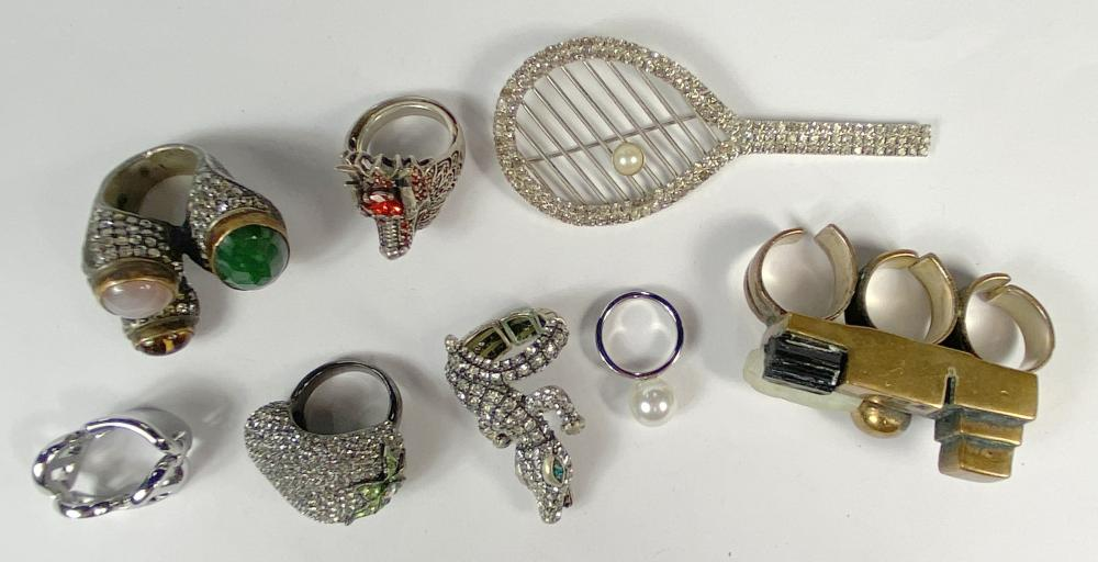A Collection of Rhinestone & Other Metal Rings & A Rhinestone Tennis Brooch