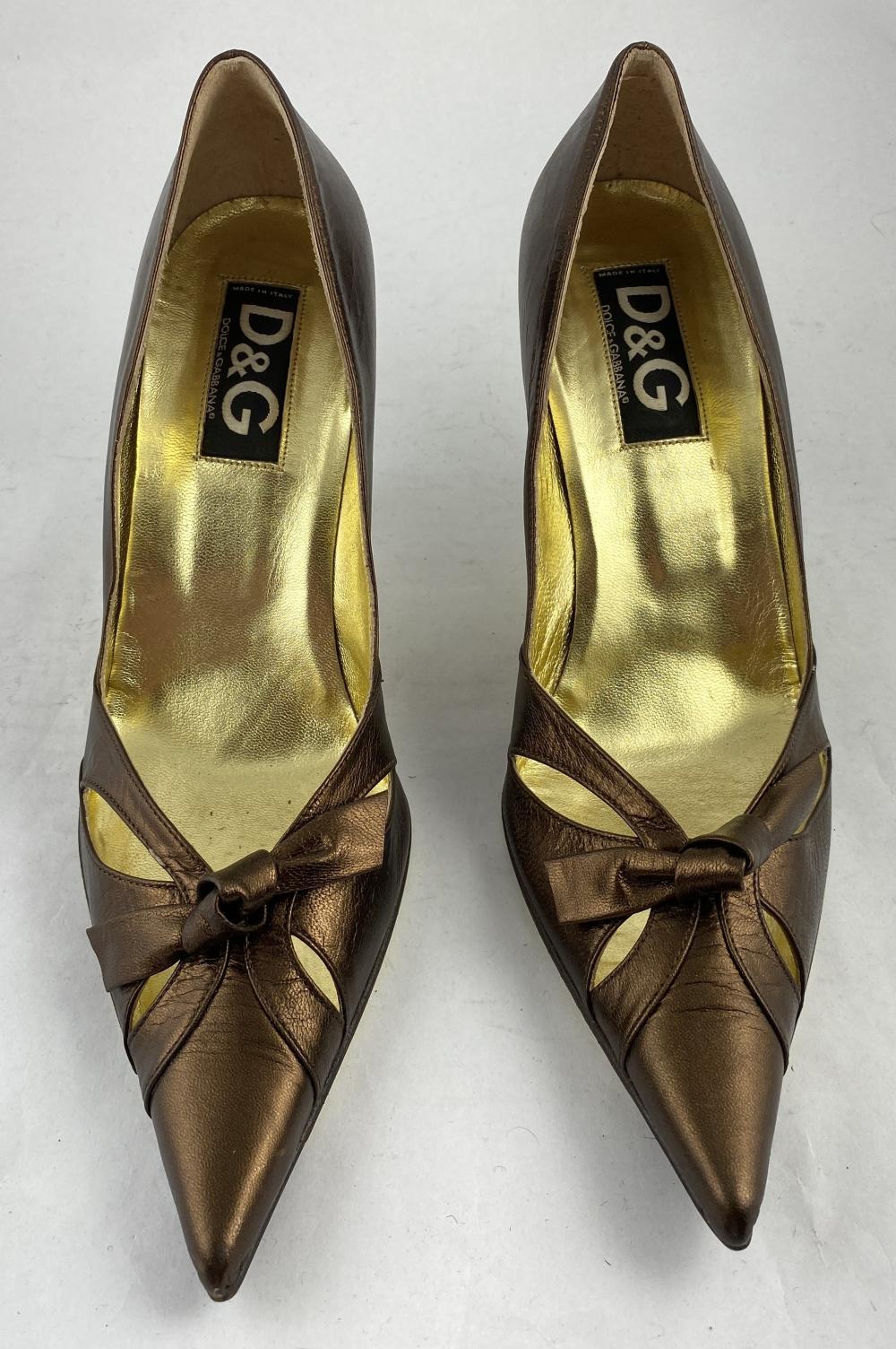 Dolce & Gabbana, Italy: Bronzetone Leather Point-Toe Stilettos, Bow Detail to Toe