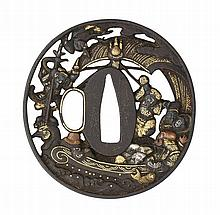 ‡ A JAPANESE DECORATED SWORD GUARD (TSUBA), EDO PERIOD of pierced and chise