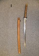 A JAPANESE W.W.II OFFICER'S SWORD (KATANA) with curved single-edged blade w
