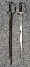 TWO 1879 PATTERN ARTILLERY SAW-BACKED BAYONETS one in it its scabbard (the