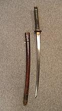 ‡ A W.W.II JAPANESE SWORD (KATANA) with slightly curved single-edged blade