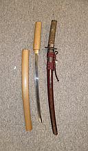 A JAPANESE SHORT SWORD (WAKIZASHI), EDO PERIOD with single-edged blade form