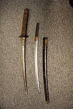 TWO JAPANESE SHORTSWORDS (WAKIZASHI) the first with curved single-edged bla