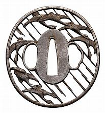 AN OVAL IRON BUSHU SUKASHI TSUBA, 19TH CENTURY