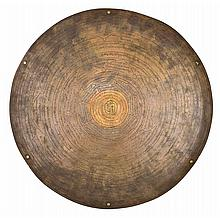 **A BRONZE ROUNDEL, TIBET, EARLY 20TH CENTURY
