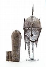 **AN INDO-PERSIAN HELMET (KULAH-KHUD) AND ARM DEFENSE (BAZU BAND), 19TH CENTURY