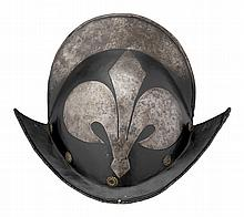 A GERMAN BLACK-AND-WHITE COMB MORION, EARLY 17TH CENTURY