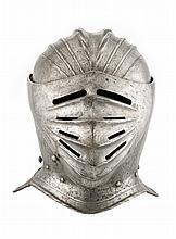 A FLUTED CLOSE HELMET IN THE SO-CALLED GERMAN 'MAXIMILIAN' FASHION OF CIRCA 1515-30, LATE 19TH/20TH CENTURY
