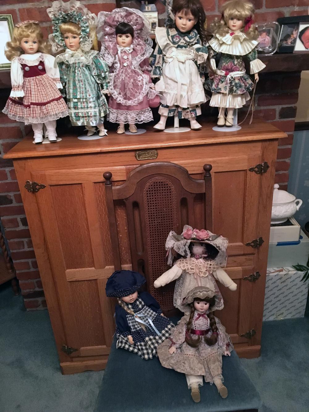 8 Porcelain Collector's Dolls.